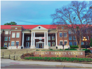 """Martindale building with a sign saying """"Student Services Center"""""""